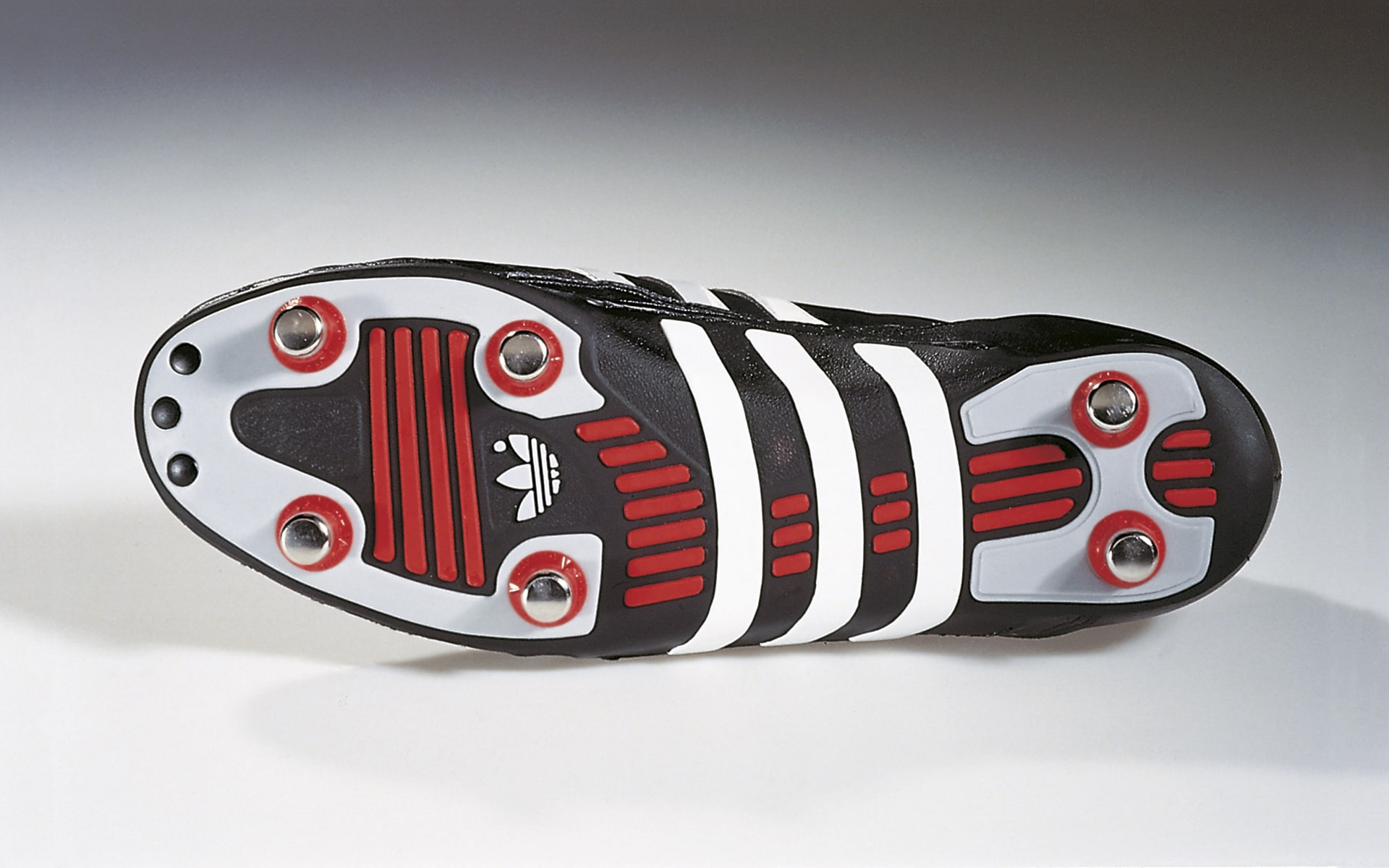 Black-red-and-white World Champion soccer shoe by ITO Design for Adidas, designed in 1990