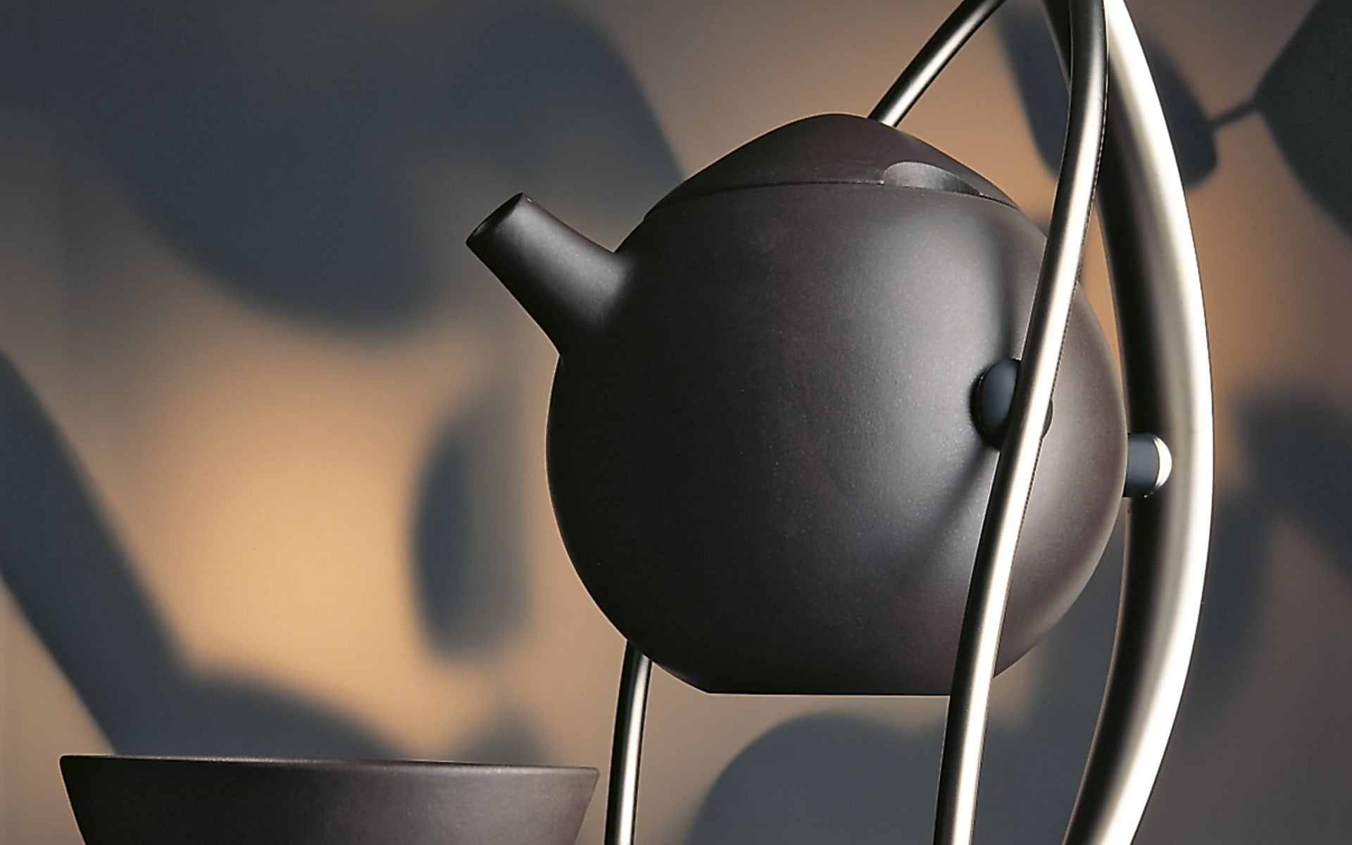 Tea set No 1 for ITO Originals, made of black-brown ceramics and metal, created in 1993