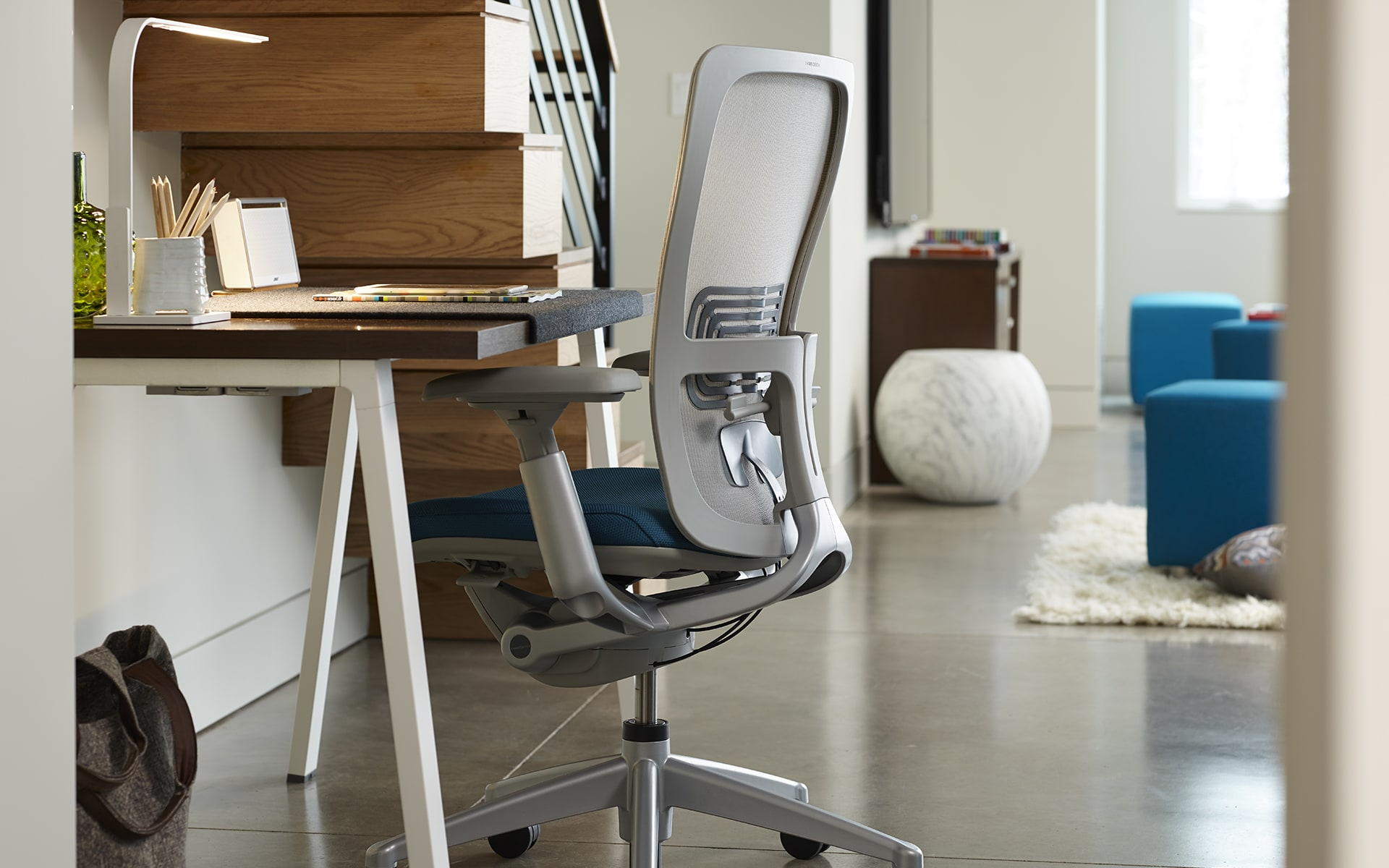 Haworth Zody office chair by ITO Design with gray backrest and blue upholstery at modern home workplace
