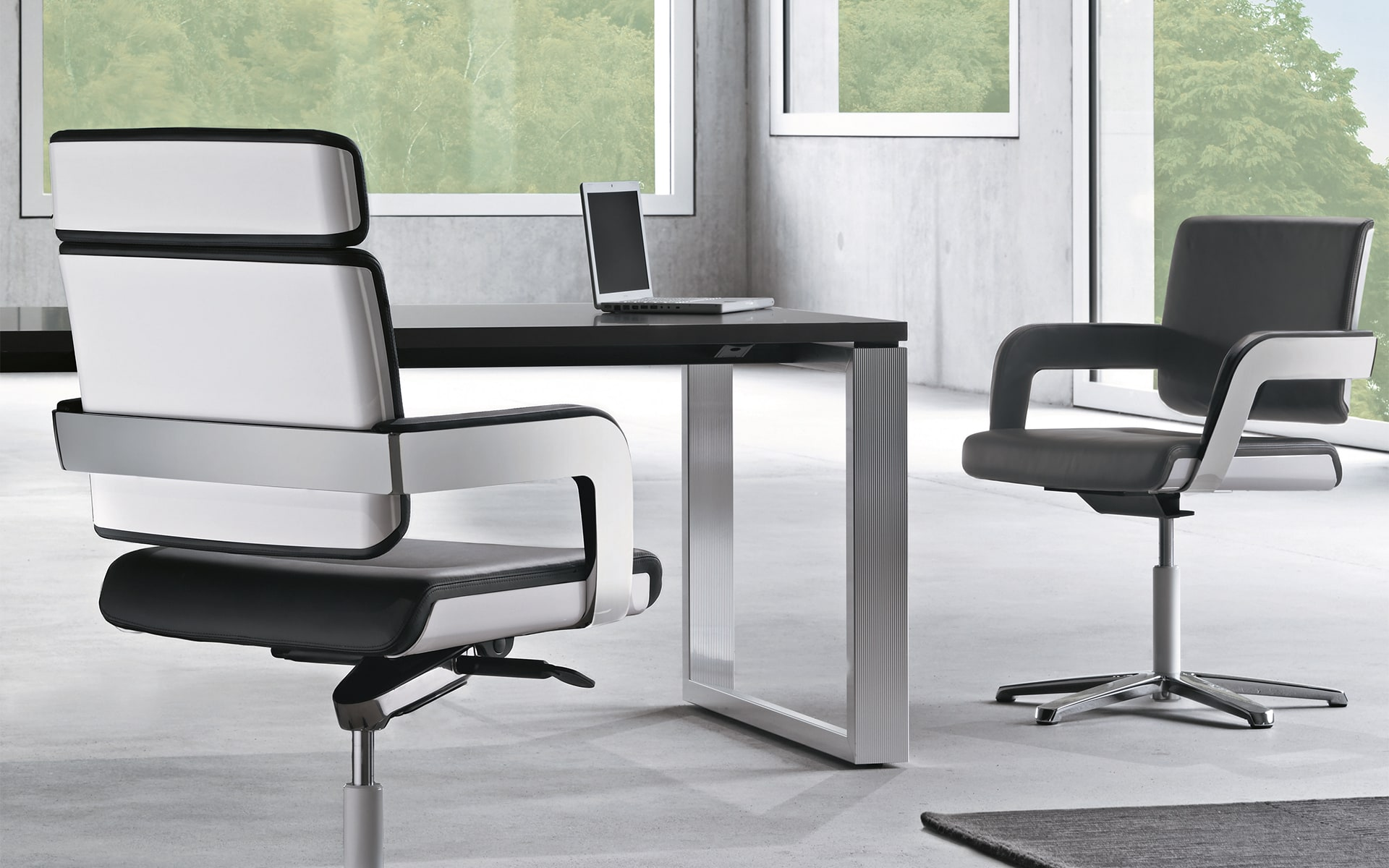 Black-and-white K+N Charta conference chairs by ITO Design in monochromatic workspace