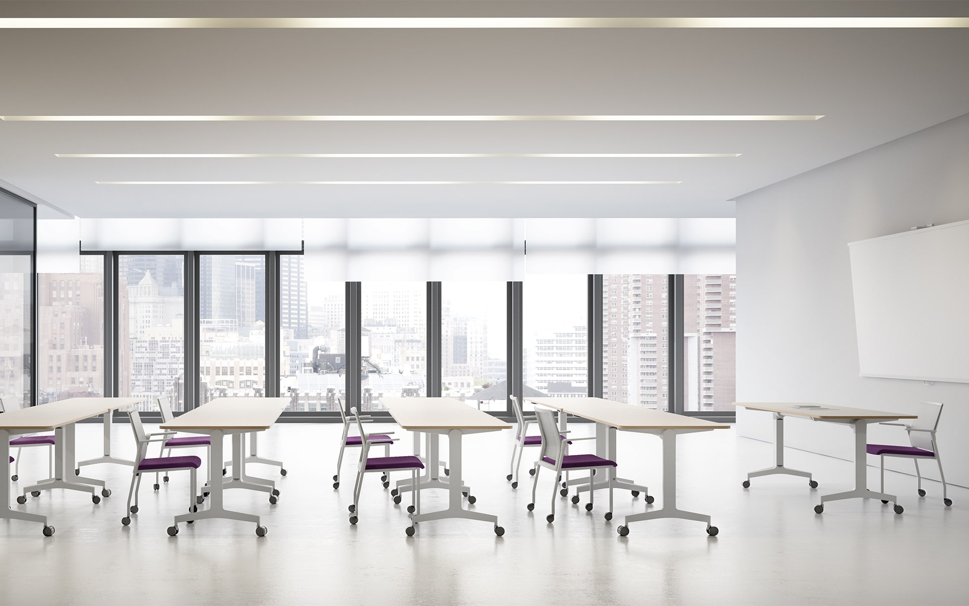 Bright training room that is furnished with Forma 5 Folding Travel folding tables by ITO Design