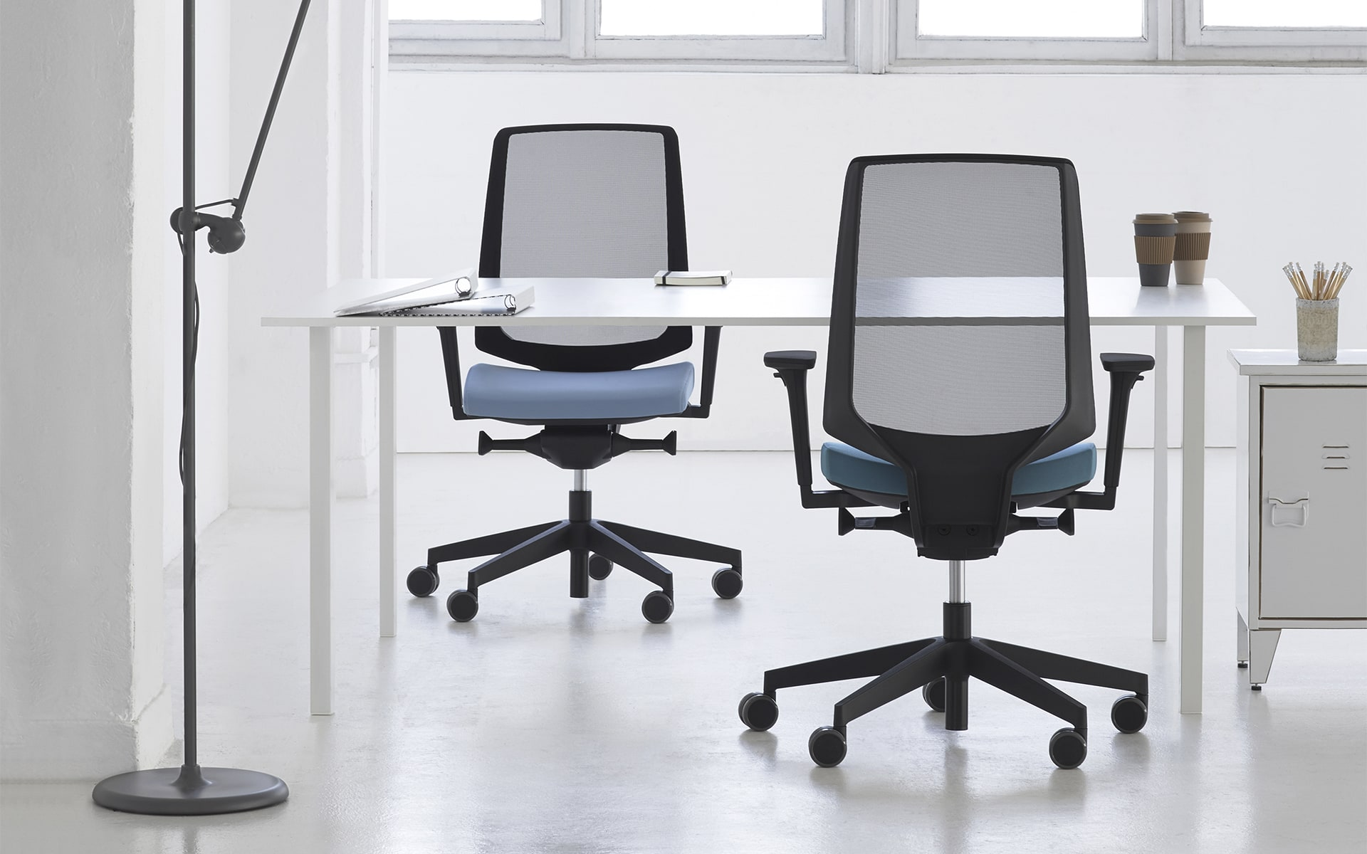 Profim LightUp office chairs by ITO Design with blue upholstery in stylish loft office