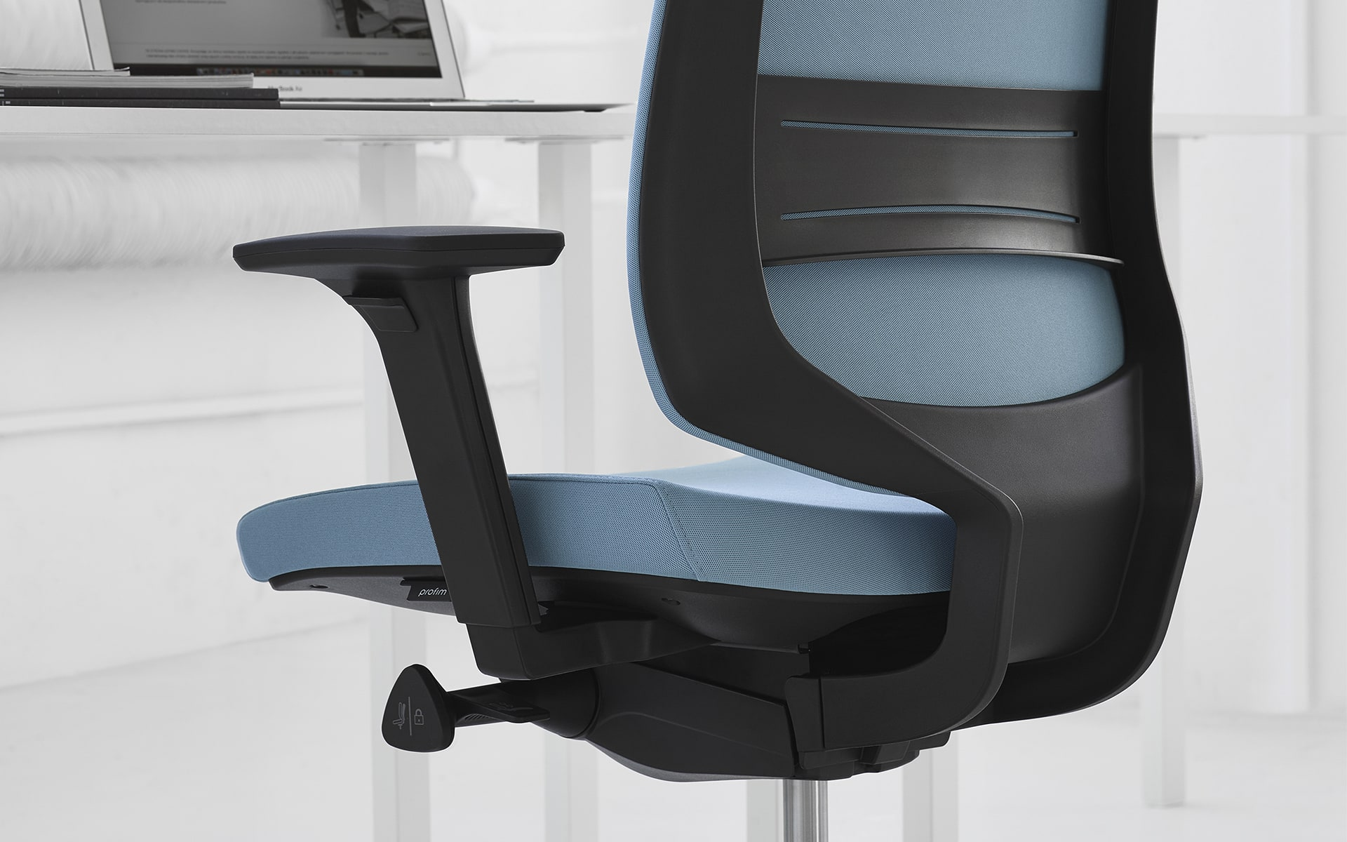 Close-up of the Profim LightUp office chair by ITO Design with blue upholstery