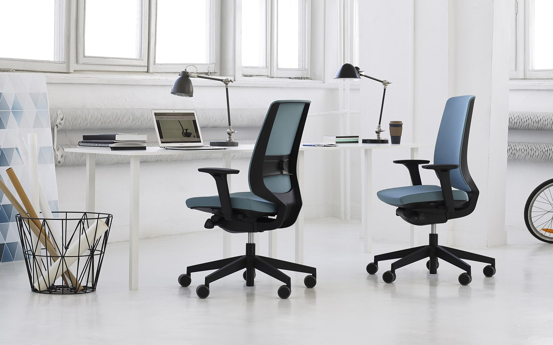 Profim LightUp office chairs by ITO Design with blue upholstery at minimalist desk
