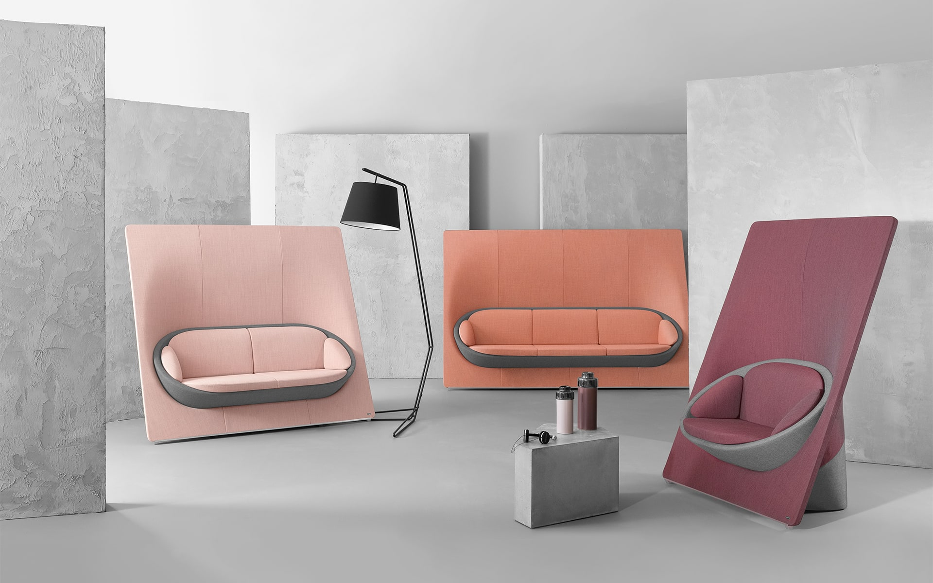 Various models of the Profim Wyspa lounge seating system by ITO Design in dusky pink, salmon and berry