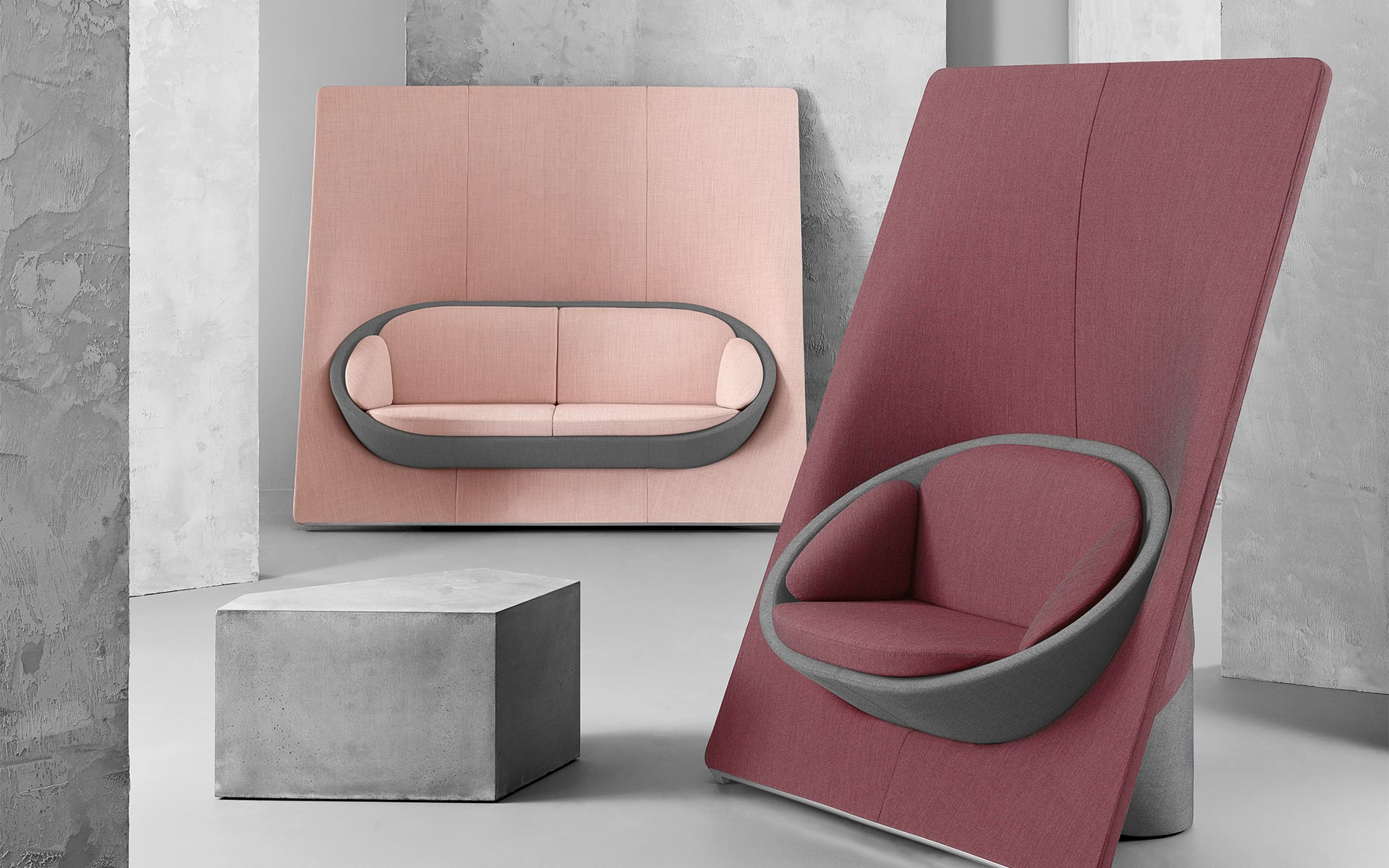 Profim Wyspa lounge seating system by ITO Design in dusky pink and berry beside concrete lounge table
