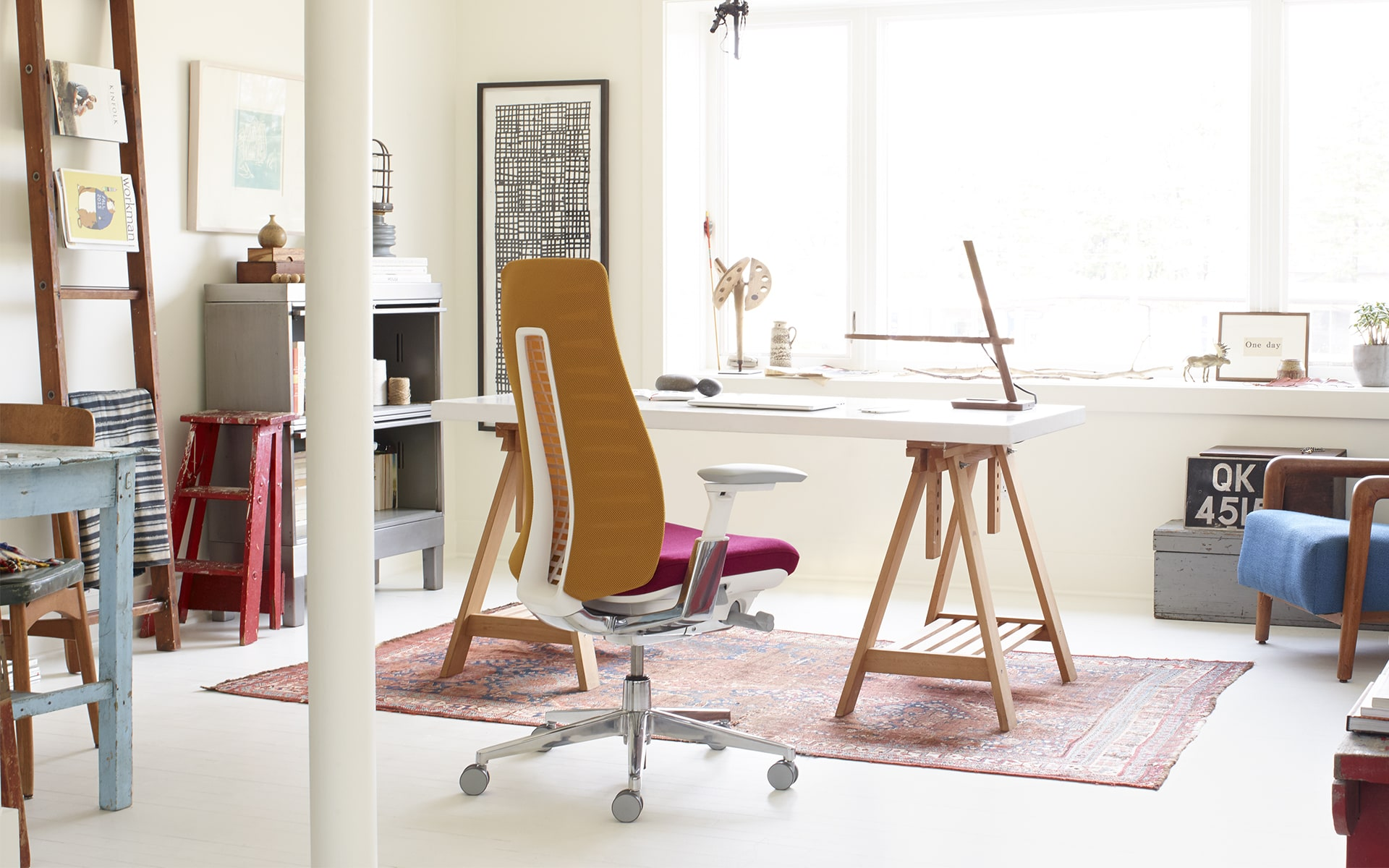 Haworth Fern office chair by ITO Design with brown backrest and hot pink upholstery in bright home office