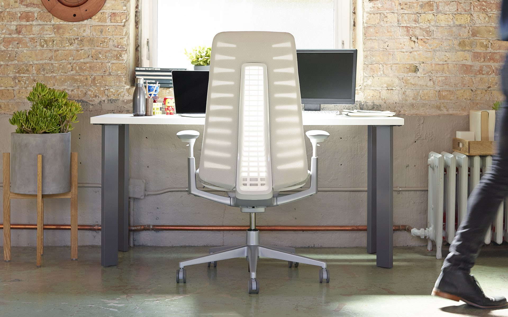 Haworth Fern office chair by ITO Design with white backrest at industrial chic workplace