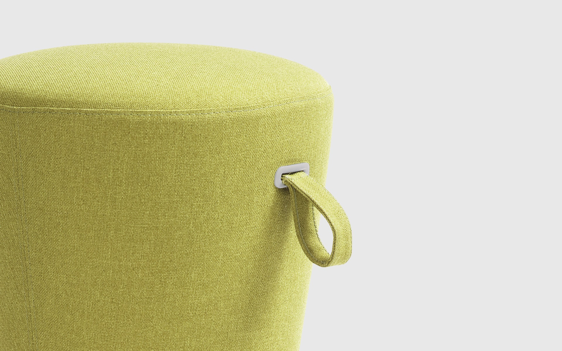 Close-up of the Profim Mickey stool by ITO Design with yellow green upholstery