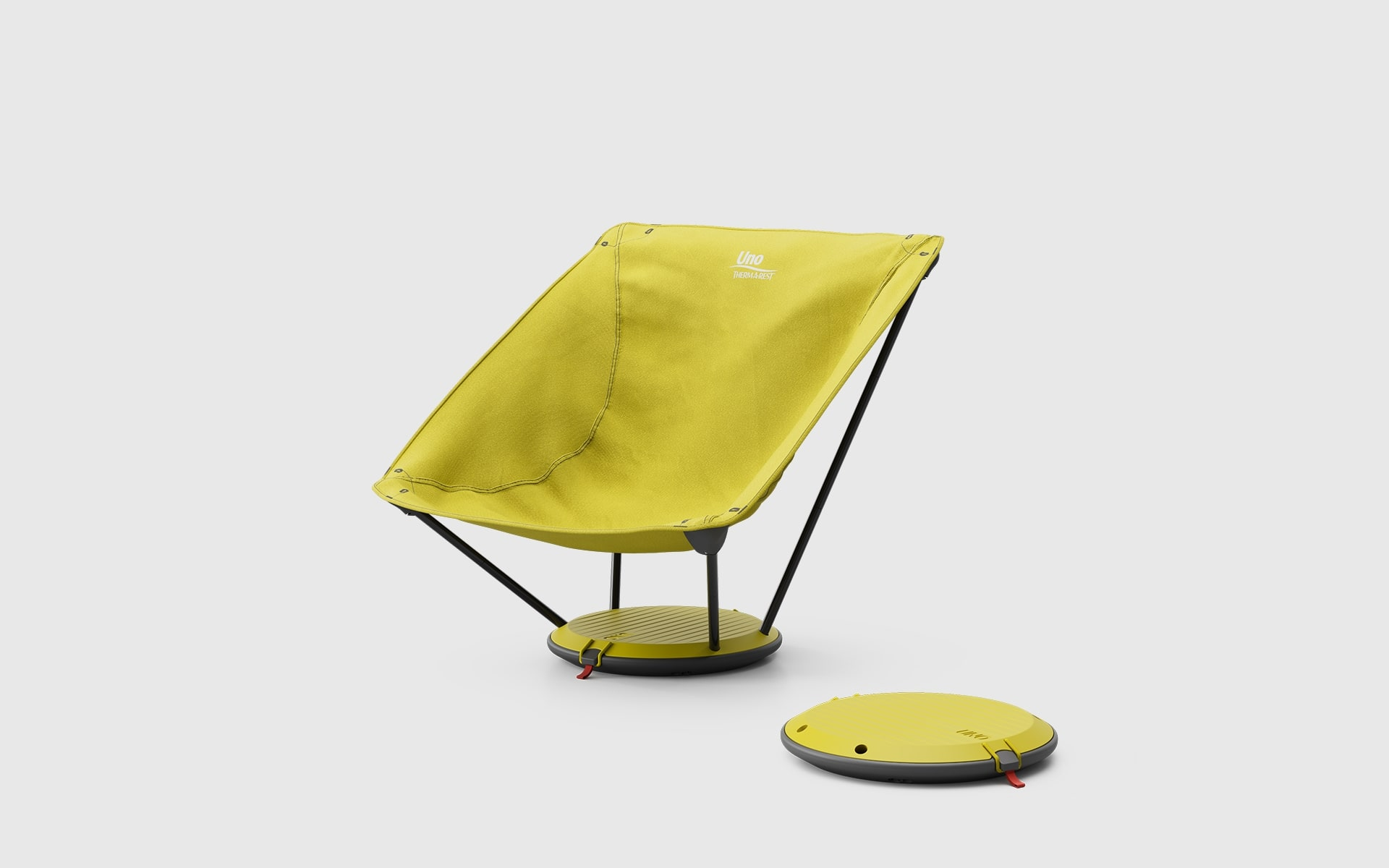 Yellow Therm-a-Rest Uno outdoor chair by ITO Design, next to it a second Uno outdoor chair packed into its own disc shaped base