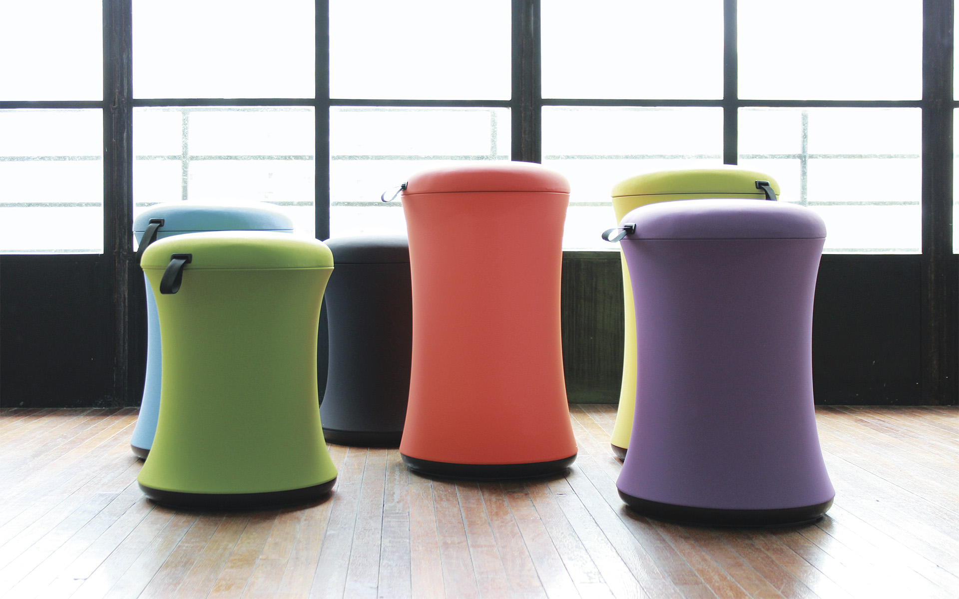 Six UE Furniture Uebobo stools by ITO Design in blue, grass-green, black, bright orange, yellow green and purple in bright room