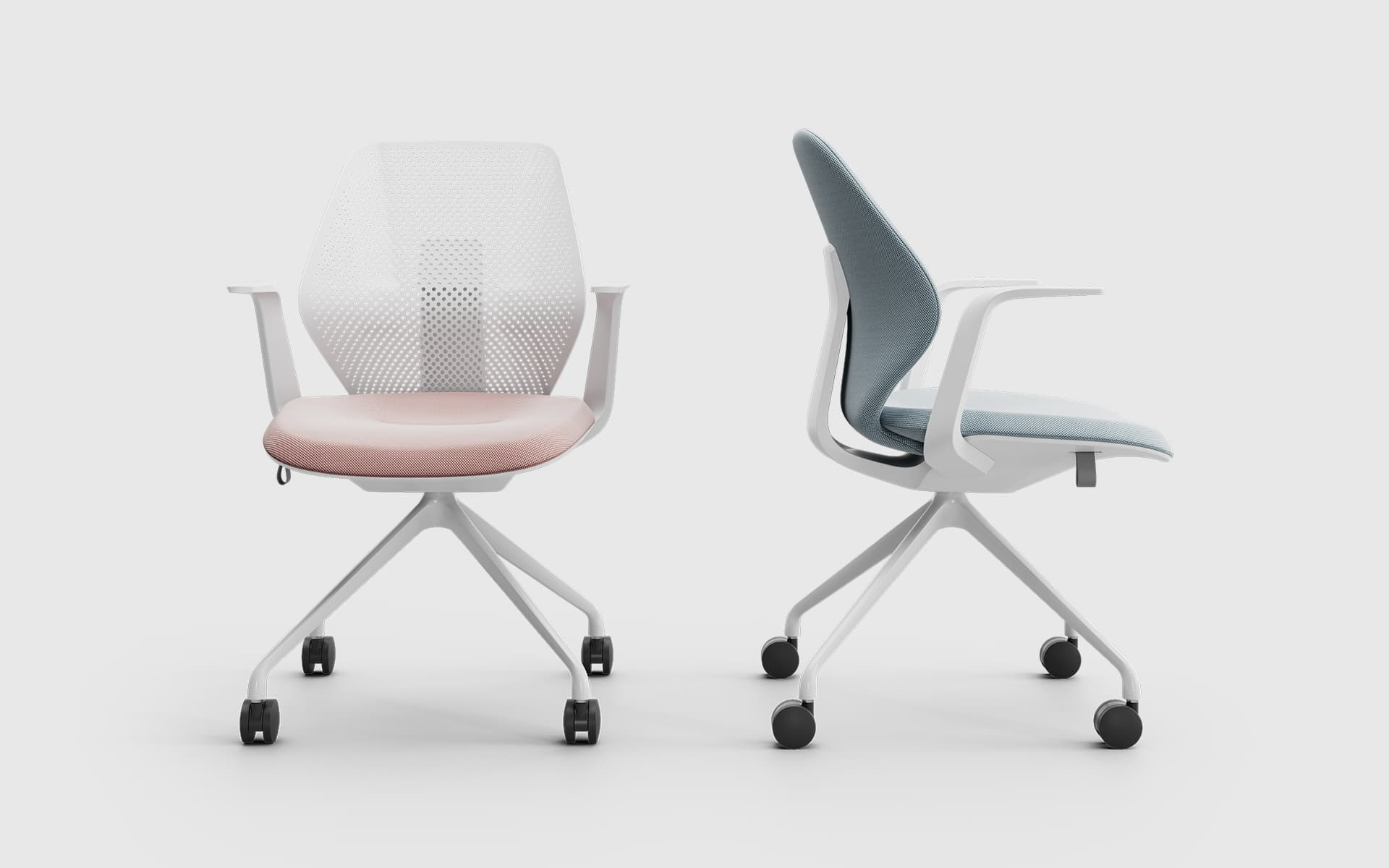 Two white ITOKI QuA office chairs by ITO Design with pink and blue