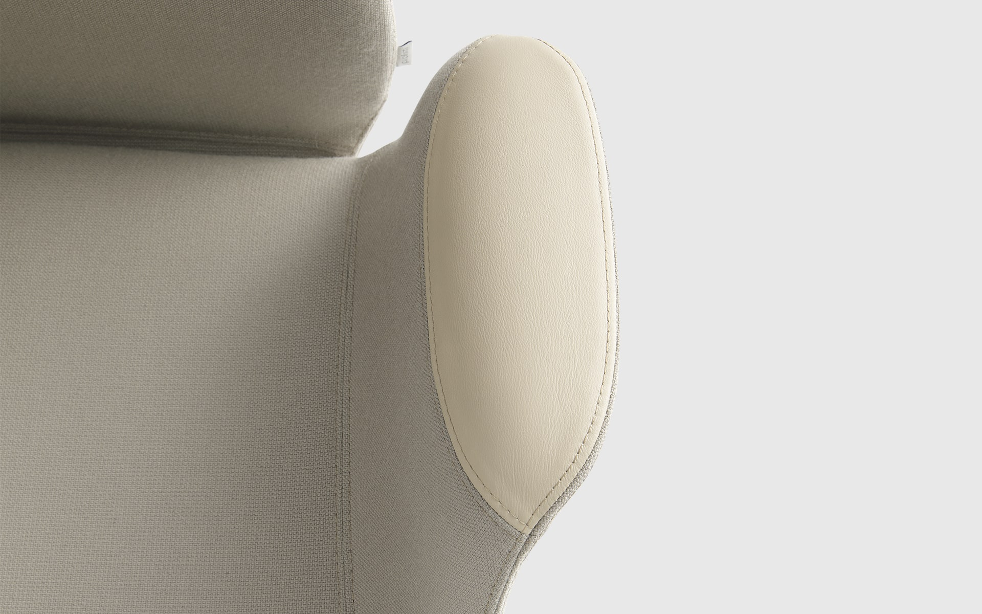 Detailed view of a cream-coloured Profim Ellie chair by ITO Design