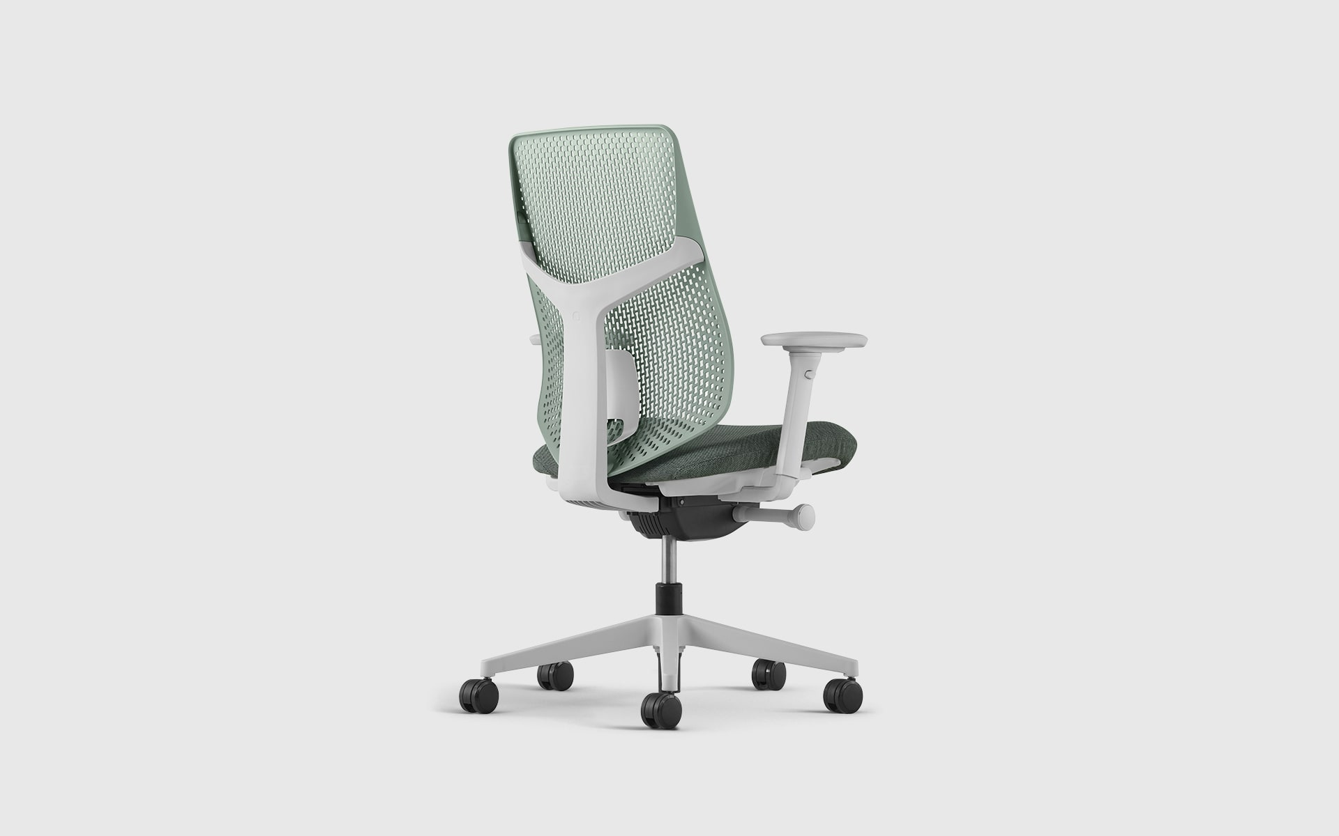 A Hermann Miller Verus office chair by ITO Design with dusty green perforated backrest and seat cushion