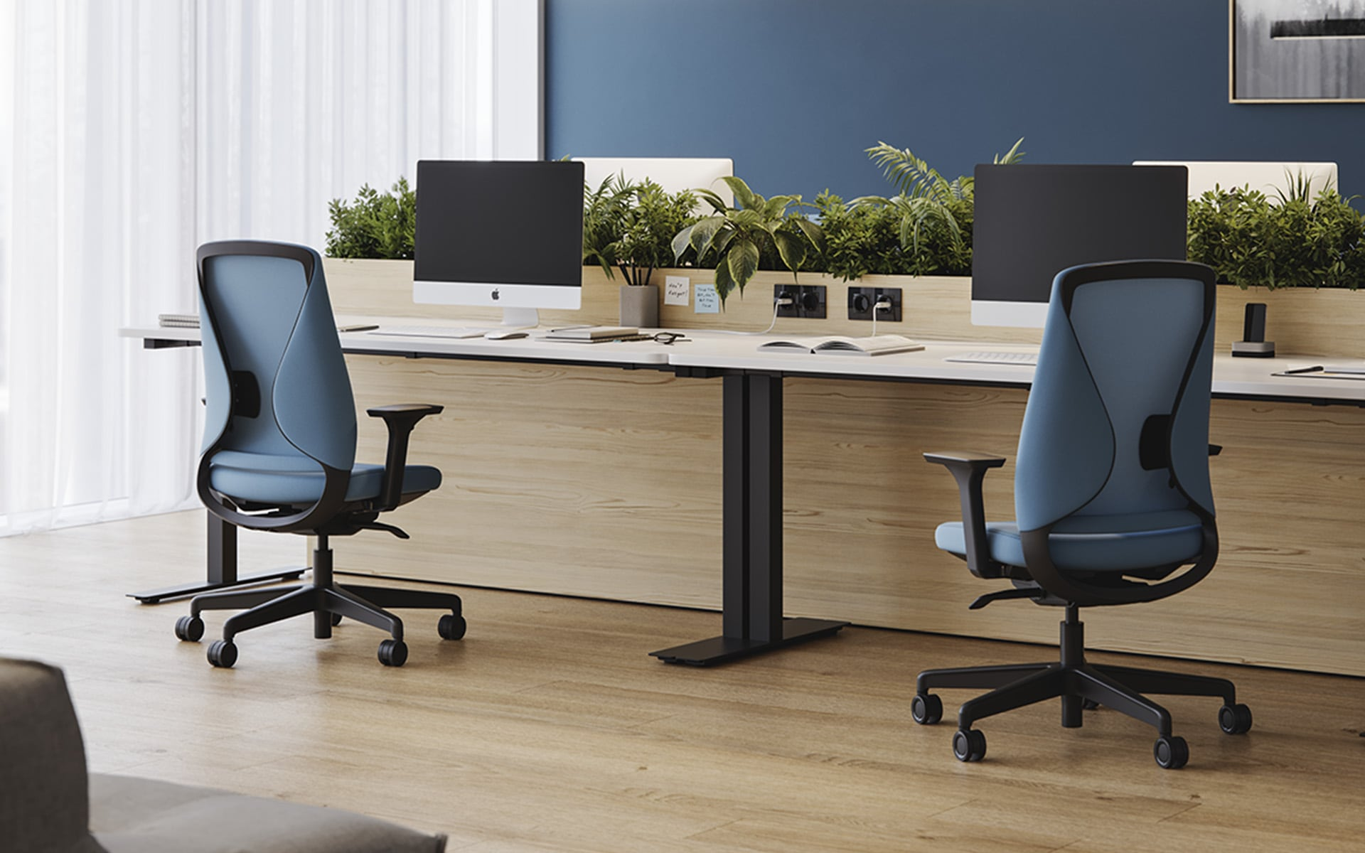 Two Comfordy Silhouette Office chairs by ITO Design with light blue upholstery in modern office with many plants