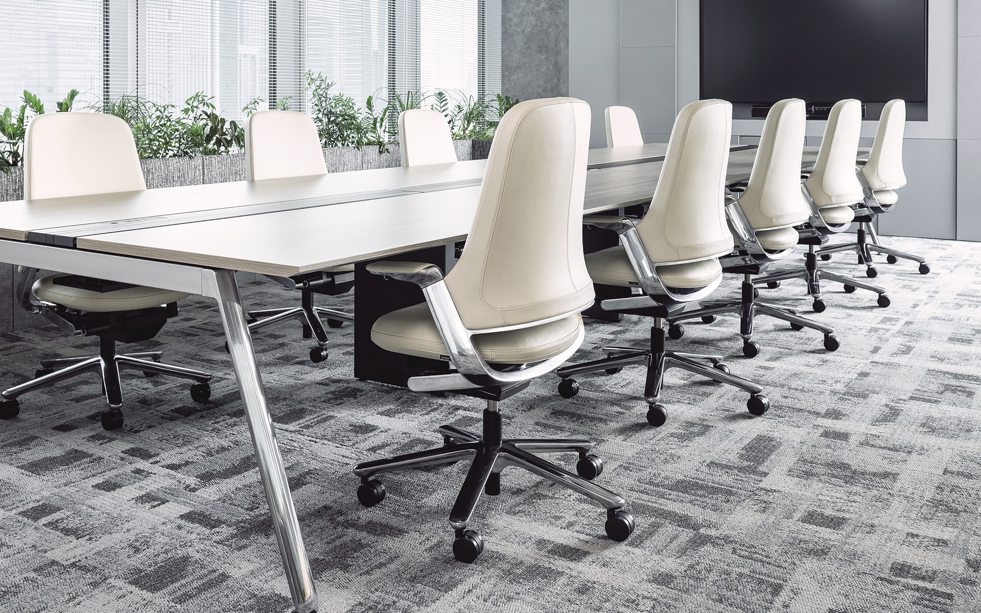 Nine white ITOKI Leonis executive chairs by ITO Design in modern conference room