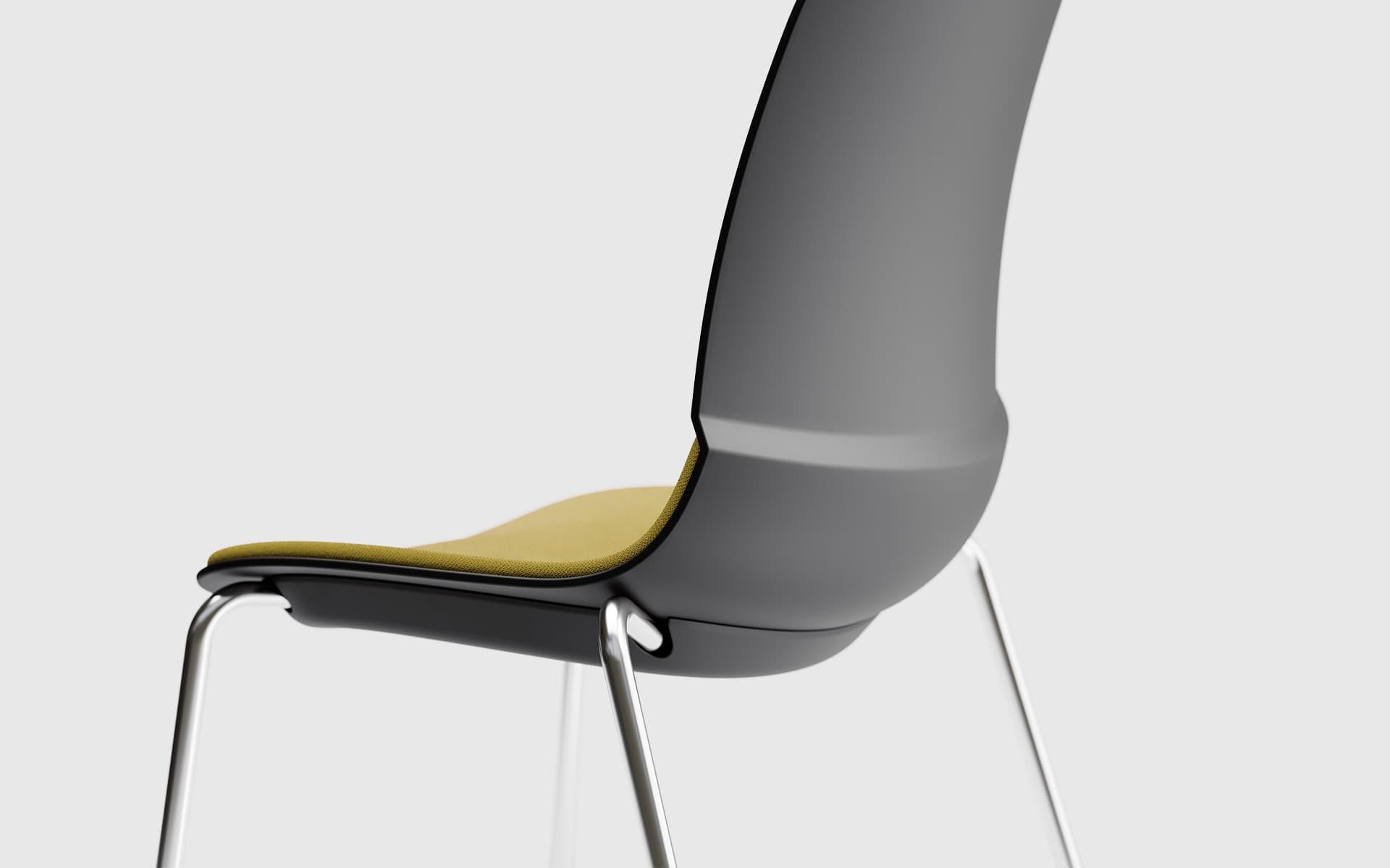 Nahaufnahme eines Patra Mika Mehrzweckstuhls von ITO Design in schwarz mit ockerfarbenem Bezug