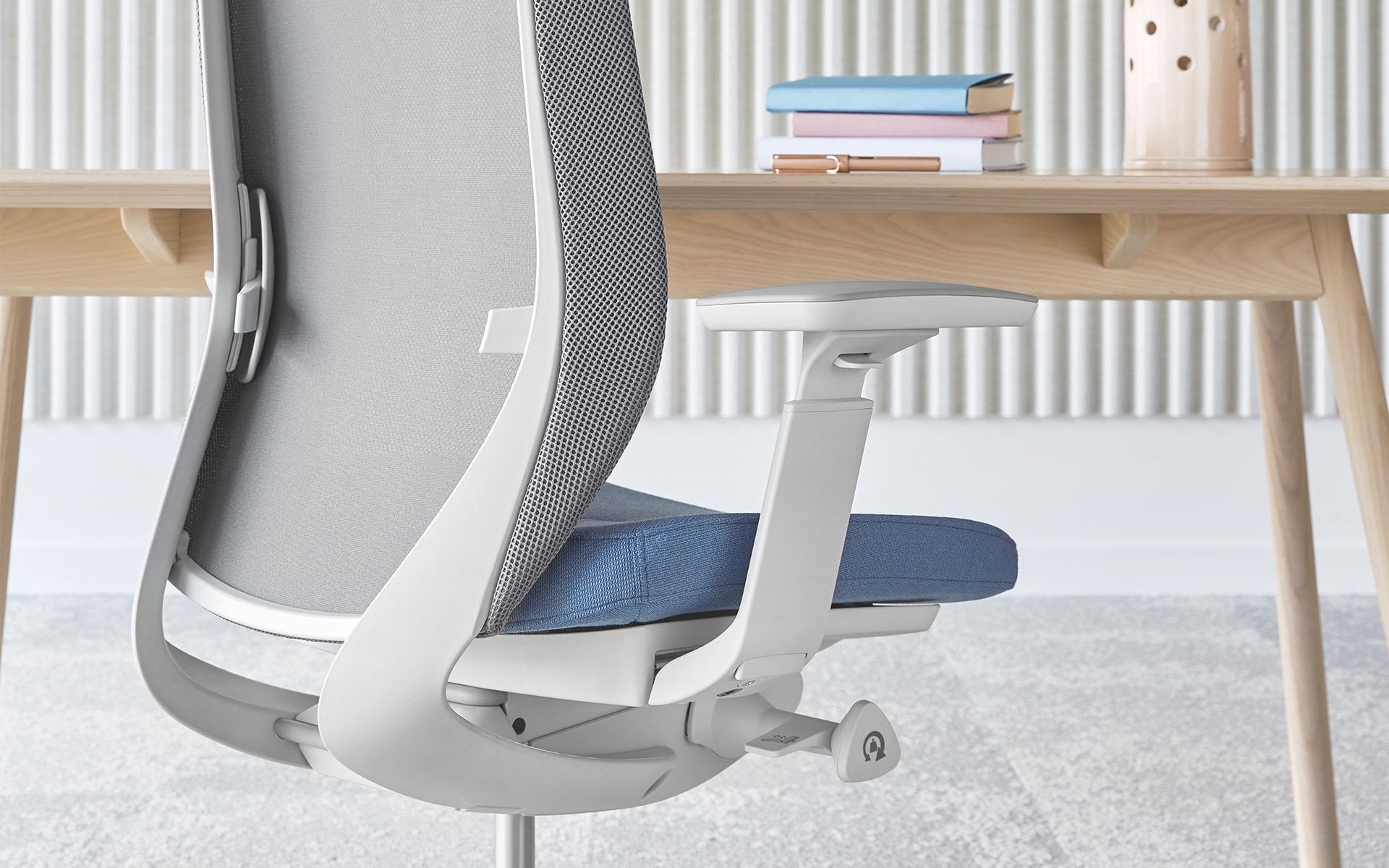 The Profim Accis Pro office chair by ITO Design in white with light blue upholstery at minimalist desk