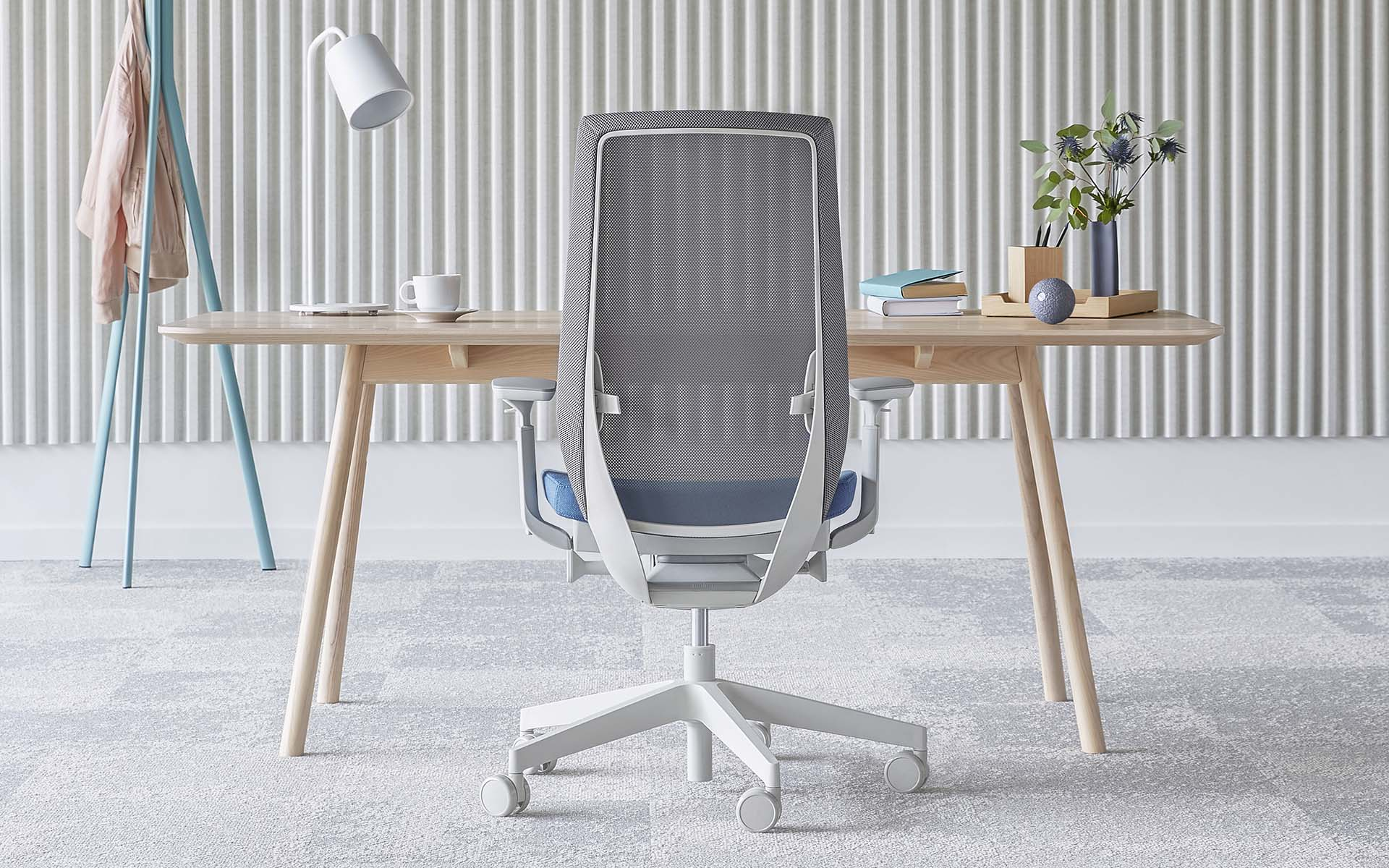 Light grey Profim Accis Pro office chair by ITO Design with light blue upholstery at minimalist desk