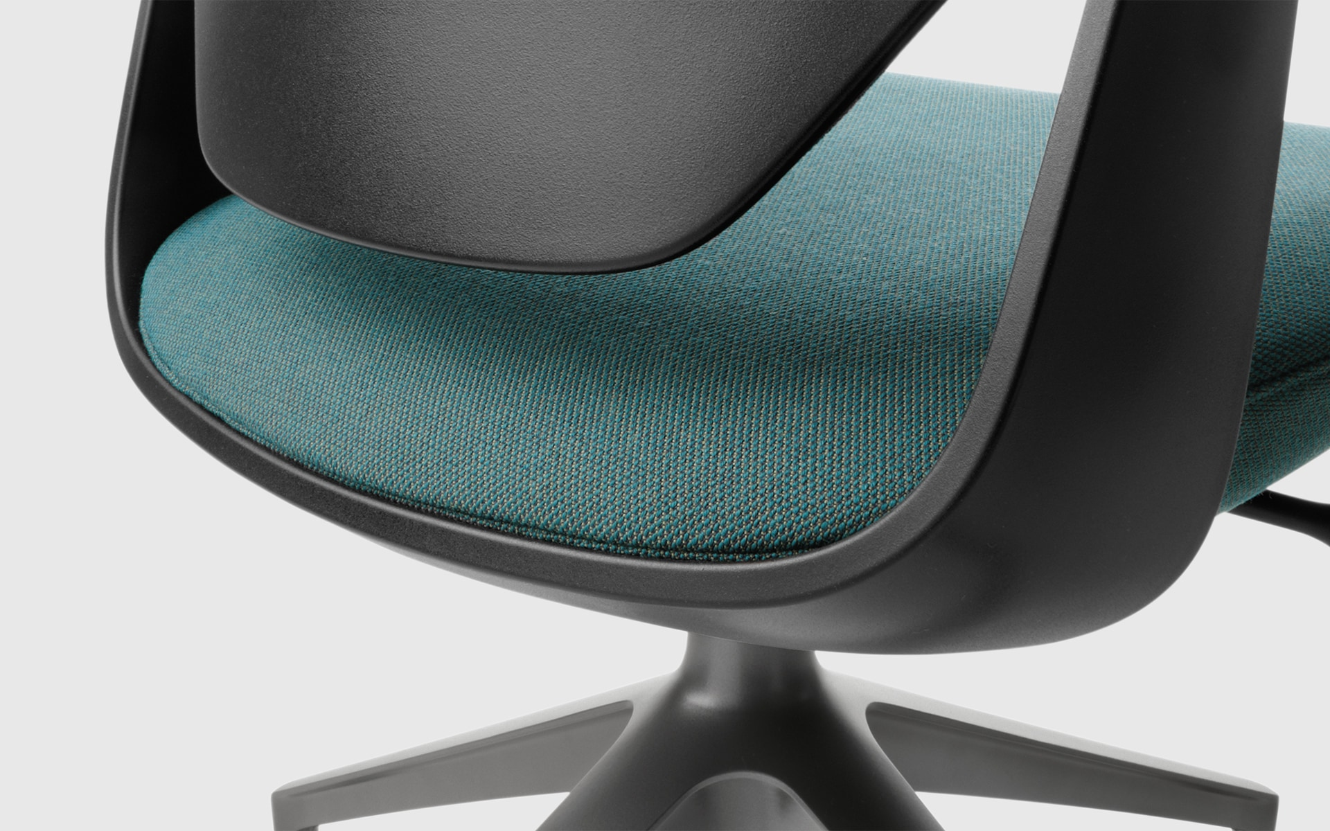 Close-up of a Profim Trillo Pro office chair by ITO Design in black with green upholstery