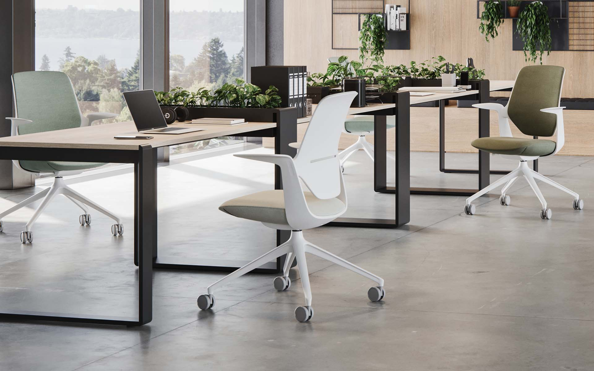 Three Profim Trillo Pro office chairs by ITO Design in sage, beige and moss at desks
