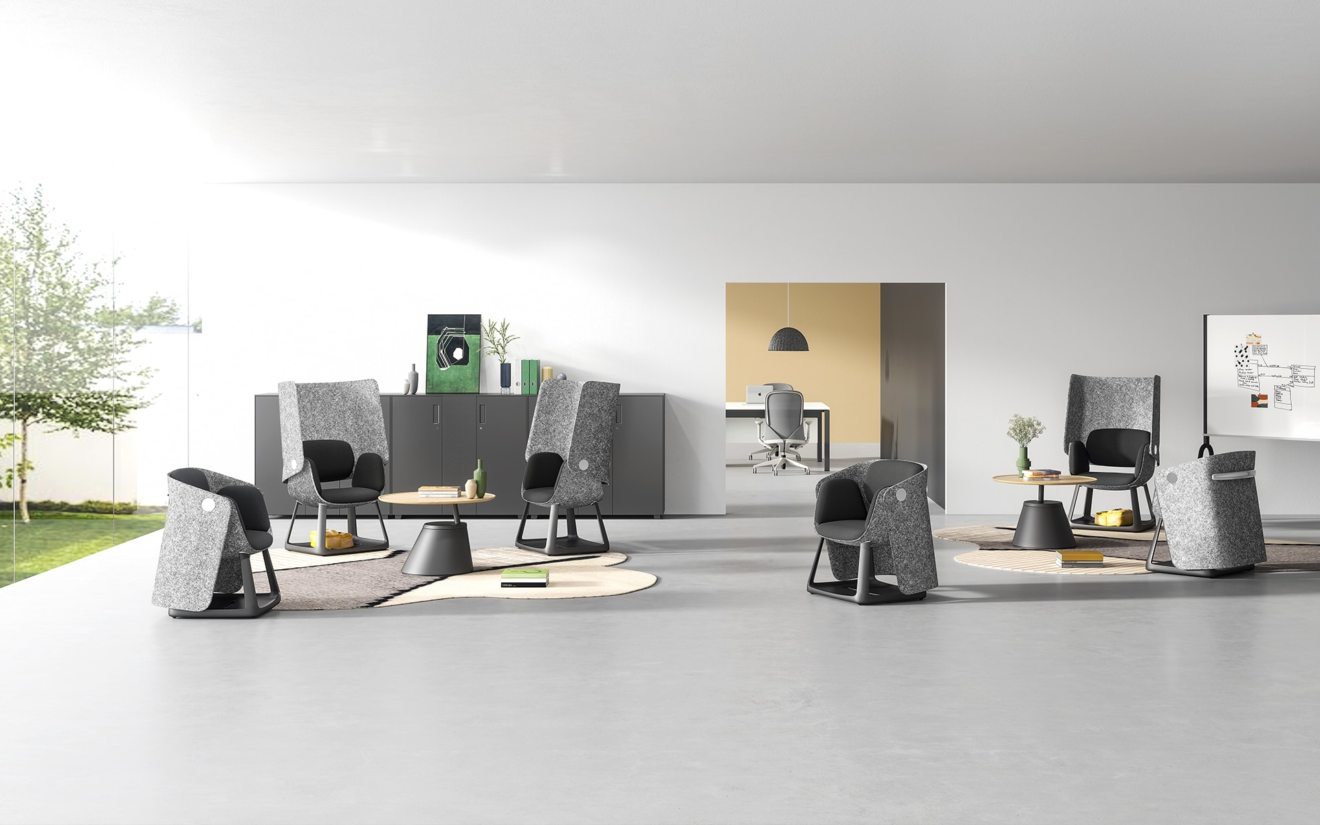 Several grey and black Sunon UF Office Chairs by ITO Design in a modern co-working space