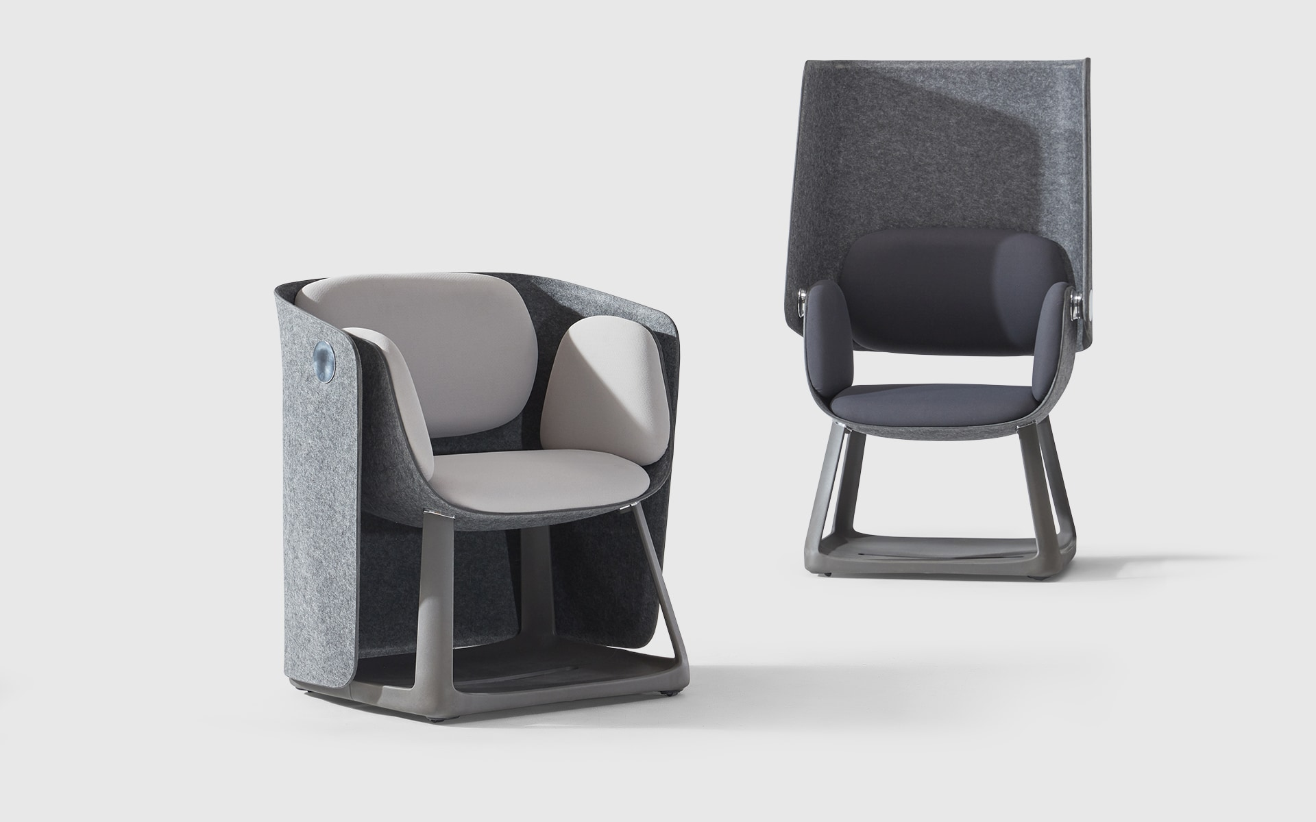 Two Sunon UF Office Chairs by ITO Design with their folding screen folded up and down