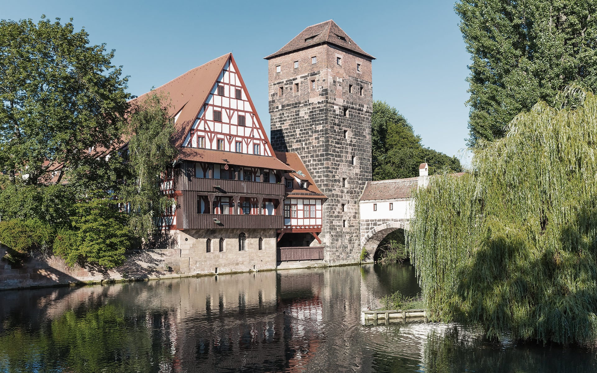 The medieval building Weinstadel and the historic water tower next to the river Pegnitz in Nuremberg, Germany