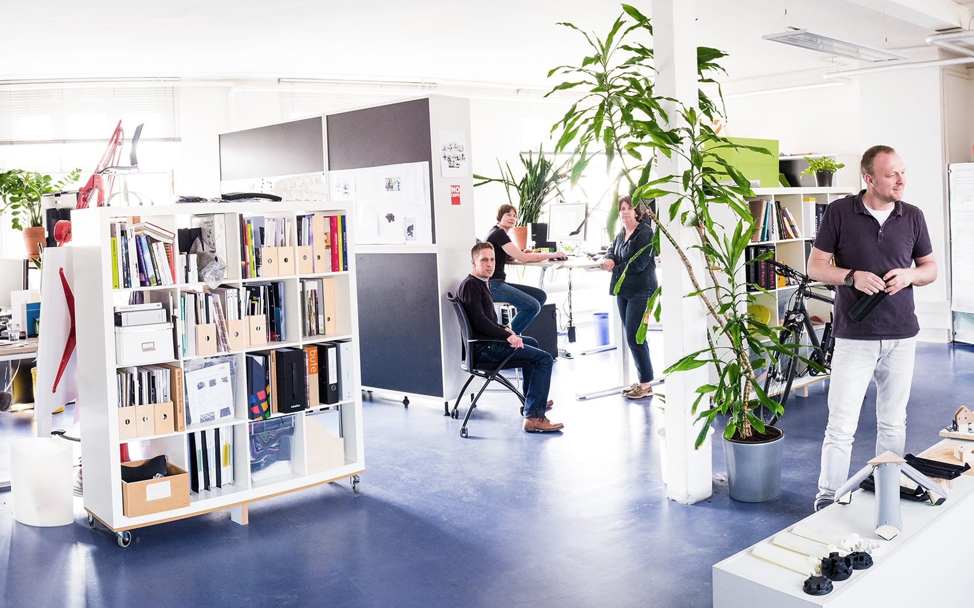 Four ITO Design colleagues in the bright open space office