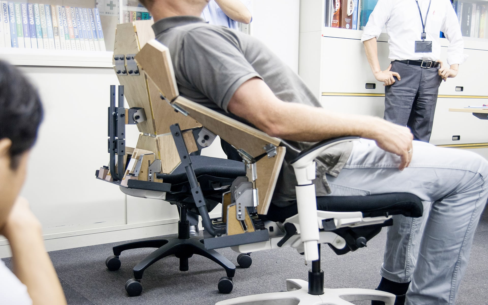 An ITO Design colleague tests the ergonomic function of the backrest of an office chair prototype