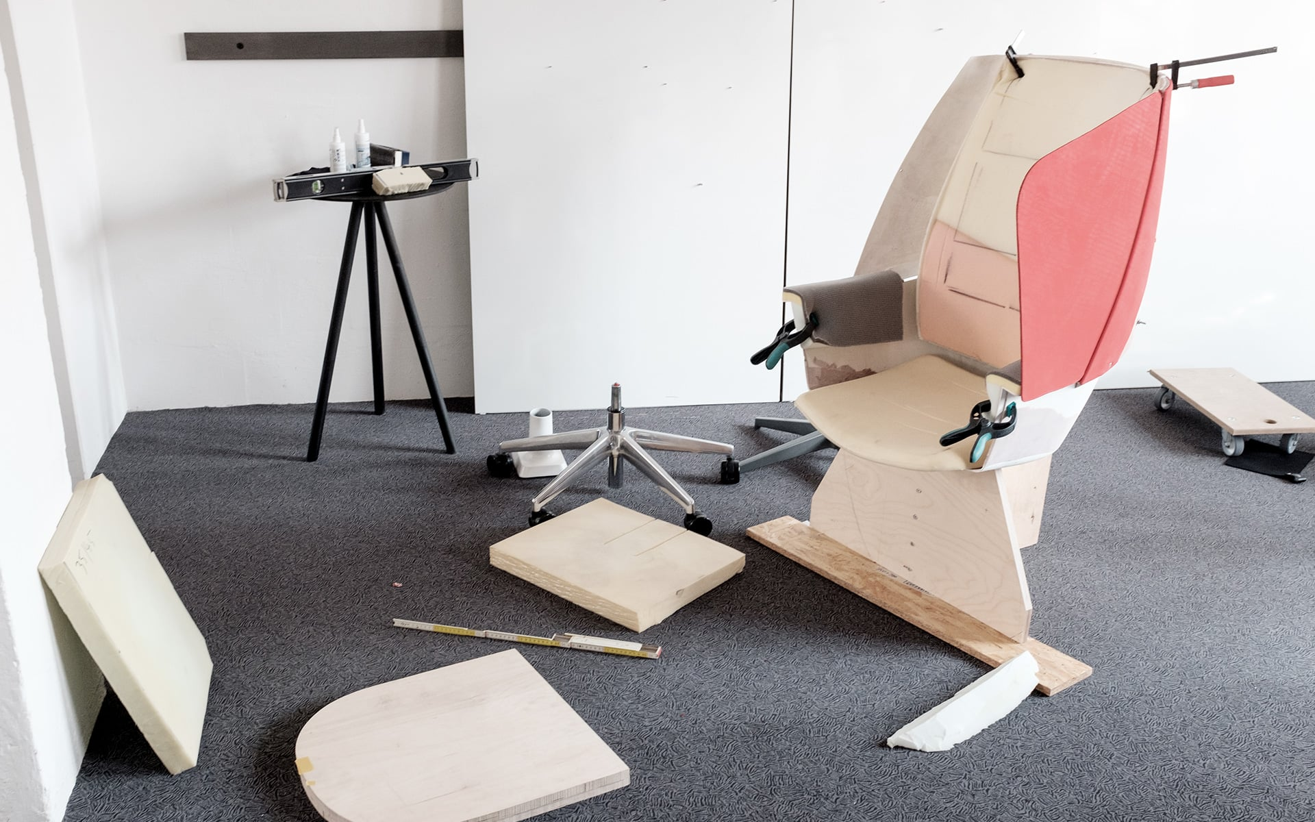 A wooden prototype of the ITO Design TeamUP office chair is being assembled