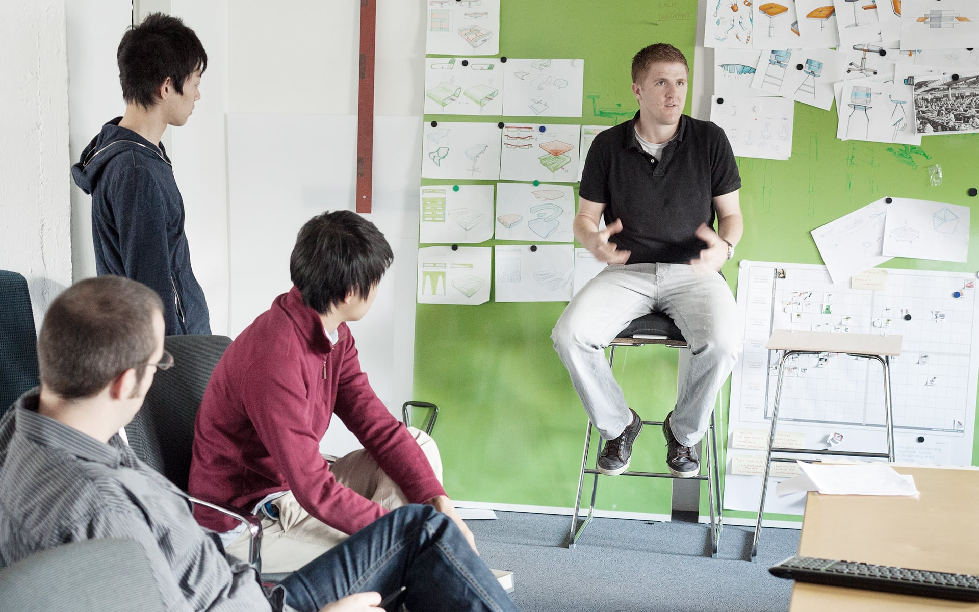 An ITO Design colleague conducts a presentation at a team meeting