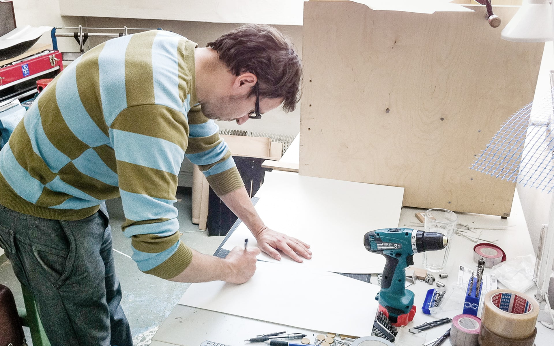 An ITO Design colleague works with a stencil for building a prototype