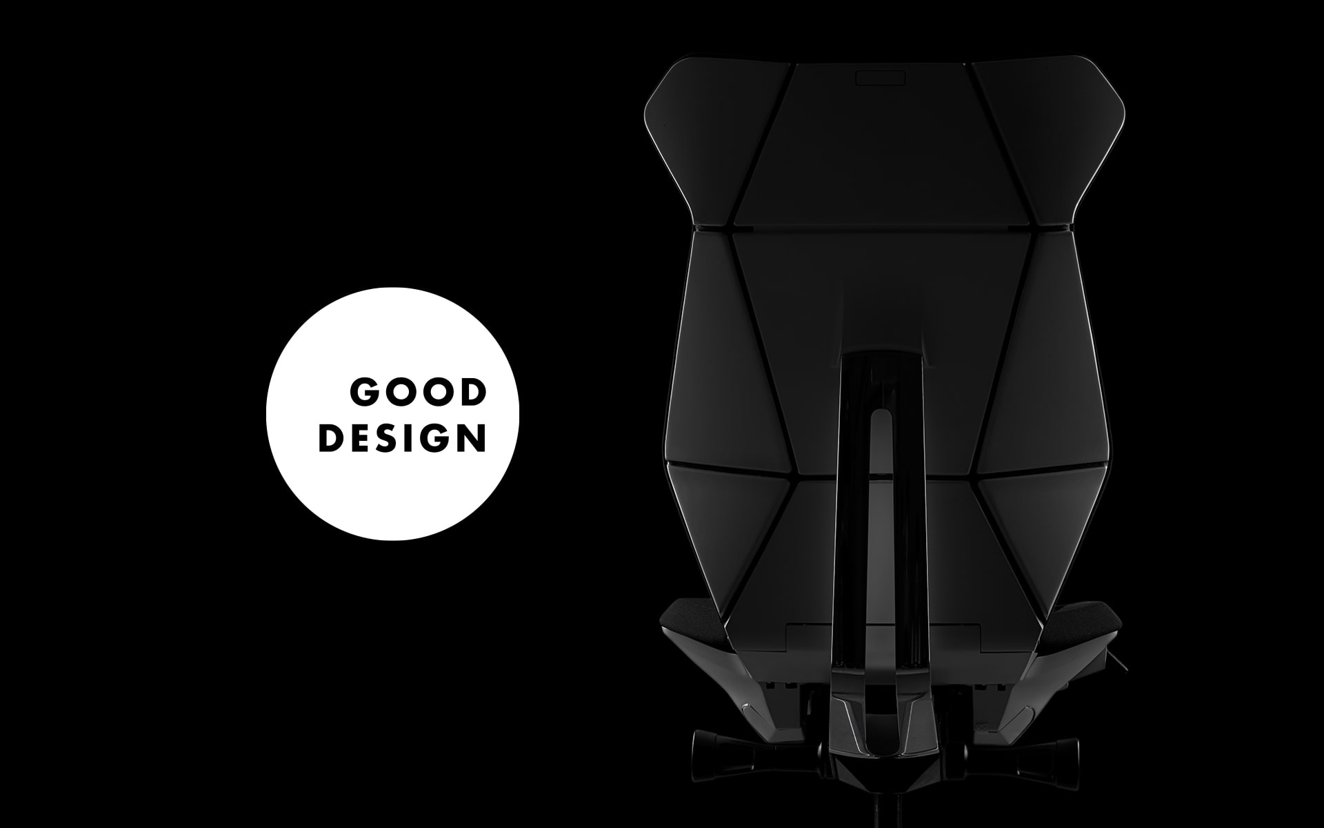 A black ITOKI FF office chair by ITO Design with origami backrest next to the logo of the Chicago Good Design Award