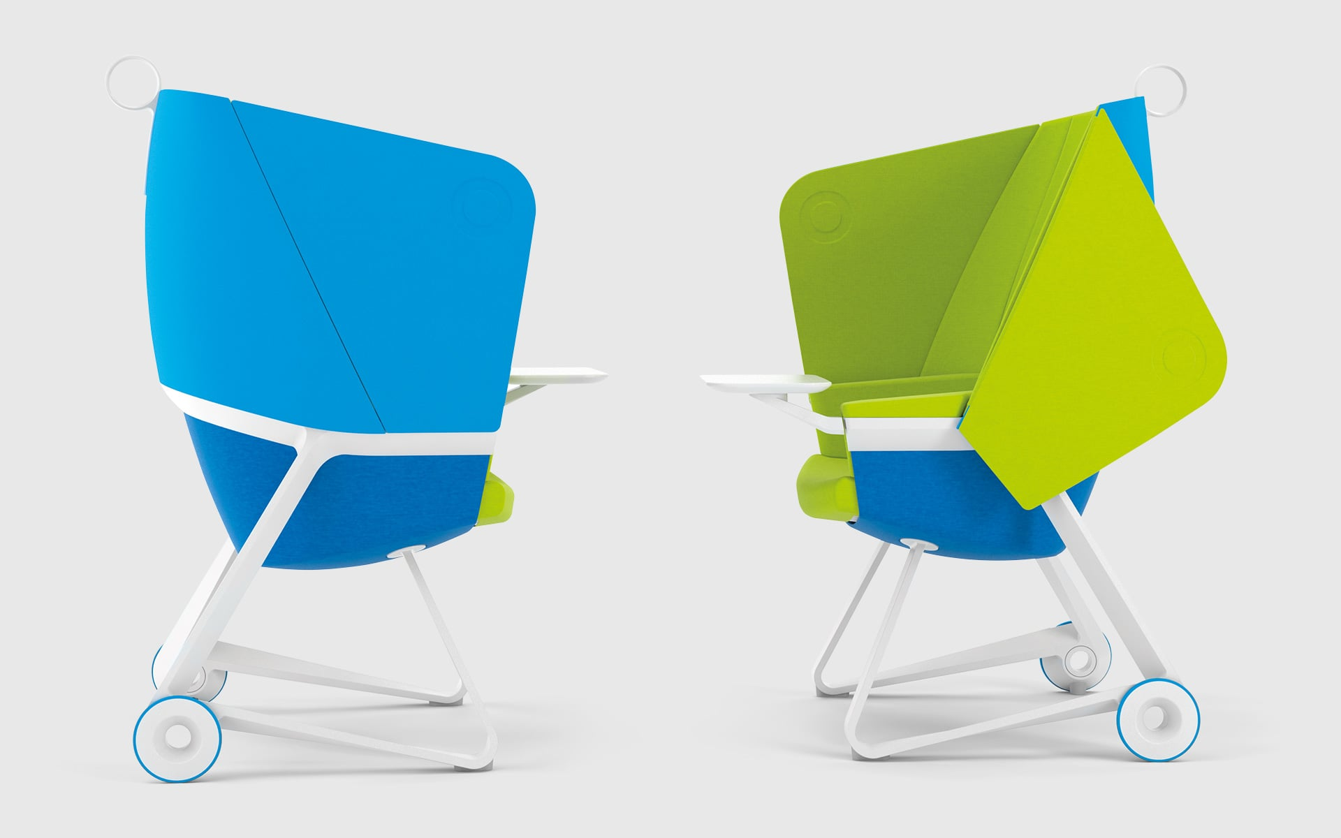 Two ergonomic ITO Design TeamUP office chairs in blue, green and white